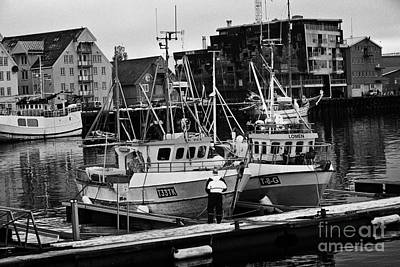 small local fishing boats in Tromso harbour troms Norway europe Poster