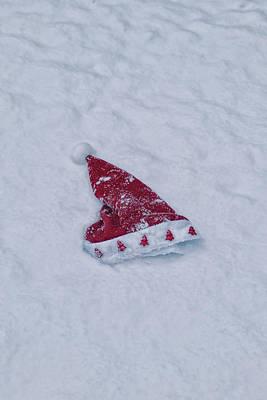 snow-covered Santa hat Poster