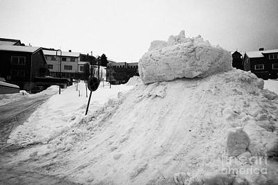snow piled up by street clearance teams Honningsvag finnmark norway europe Poster by Joe Fox