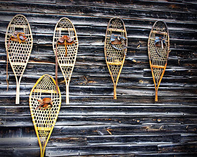 Snowshoes On A Wooden Barn Poster by Norman Pogson