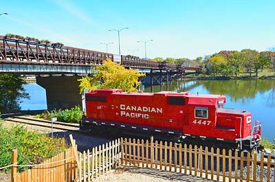 Solo Red Canadian Pacific Engine Along Rock River In Rockford Poster
