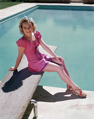 Sonja Henie Sitting On The Diving Board Poster by Artist Unknown