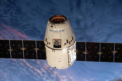 Spacex Dragon Capsule At The Iss Poster by Nasa