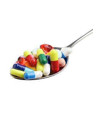Spoon Full Of Tablets And Capsules Poster by Science Photo Library