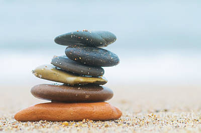 Stack Of Beach Stones On Sand Poster by Michal Bednarek