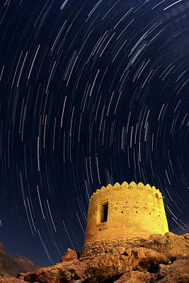 Star Trails Over Ancient Watchtower Poster by Babak Tafreshi