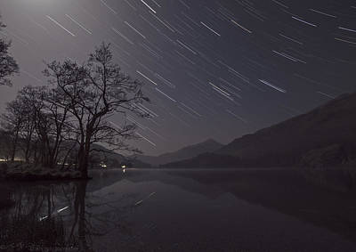 Star Trails Over Lake Poster by Beverly Cash