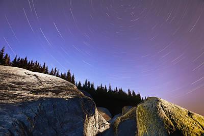 Star Trails Over Rocks In Saguenay-st Poster