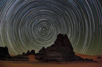 Star Trails Over Saharan Rock Formations Poster