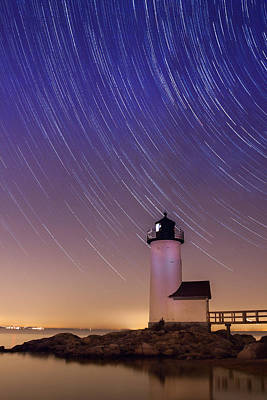Poster featuring the photograph Stars Trailing Over Lighthouse by Jeff Folger
