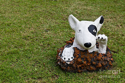 Statue Of A Dog Decorated On The Lawn Poster