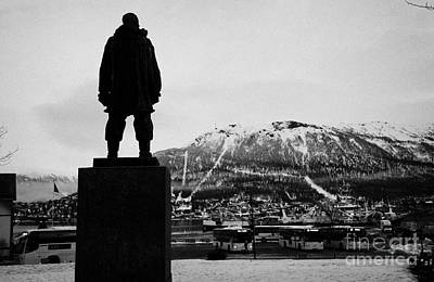 statue of adventurer roald amundsen looks out over Tromso harbour and  floya mountain troms Norway e Poster by Joe Fox