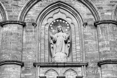 Statue On Facade Of Notre Dame Church Poster by David Chapman
