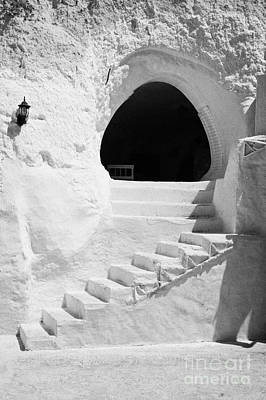 steps up to the entrance of one of the caves at the Sidi Driss Hotel underground at Matmata Tunisia scene of Star Wars films vertical Poster