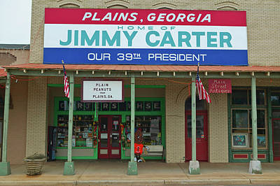 Storefront With Banner Exclaiming Poster