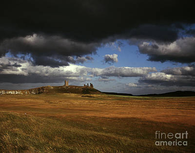 Storm Clouds And Dunstanburgh Castle  At Embleton Bay Embleton Northumberland England Poster by Michael Walters
