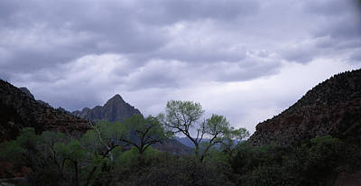 Storm Clouds Over A Mountain Range Poster
