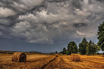 Storm Clouds Over Harvested Field In Poland 2 Poster by Julis Simo