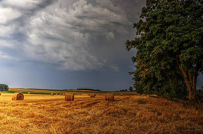 Storm Clouds Over Harvested Field In Poland Poster