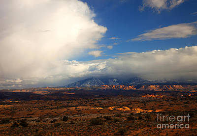 Storm Over The La Sals Poster by Mike  Dawson