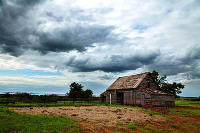 Storms Loom Over Barn On The Prairie Poster