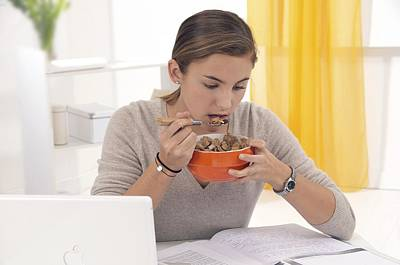 Student Eating Cereal Poster by Science Photo Library