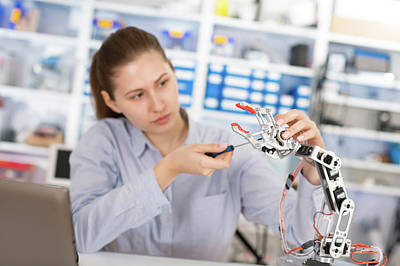 Student Repairing Robotic Equipment Poster