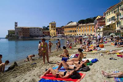 Sun Bathers In Sestri Levante In The Italian Riviera In Liguria Italy Poster