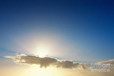 Sunbeams Behind Clouds Poster