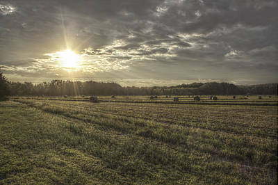 Sunrise Over Hayrolls Poster by Jason Politte