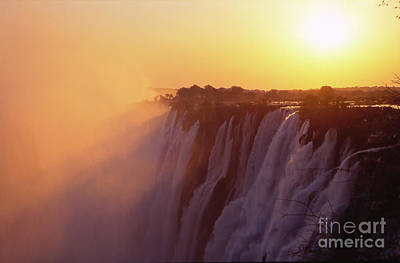 Sunset Over The Victoria Falls Poster by Alex Cassels