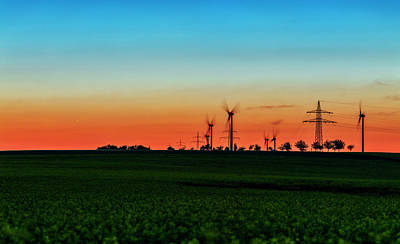 Sunset Over Wind Turbines Poster