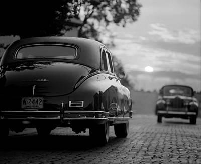Sunset Packards Poster by Jon Neidert