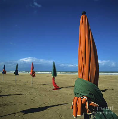 Sunshade On The Beach. Deauville. Normandy. France Poster by Bernard Jaubert