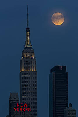 Super Moon By The Empire State Building Nyc Poster by Susan Candelario