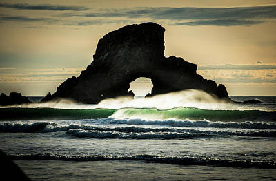 Surf Breaks Near A Natural Arch  Cannon Poster by Robert L. Potts