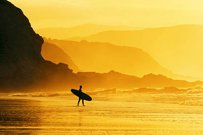 Surfer Entering Water At Misty Sunset Poster by Mikel Martinez de Osaba