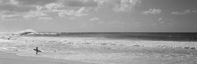 Surfer Standing On The Beach, North Poster by Panoramic Images