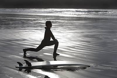 Surfer Stretching On Beach Poster by Deddeda