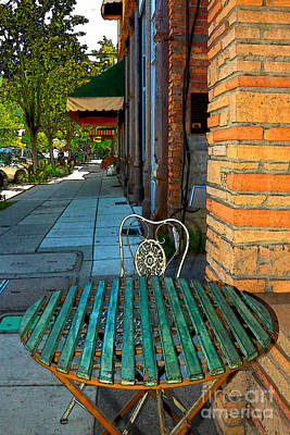 Table On A Sidewalk Poster by James Eddy