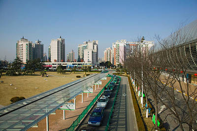 Taxis Parked Outside A Maglev Train Poster