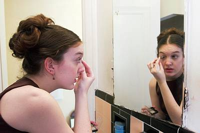 Teenage Girl Applying Make-up Poster by Jim West