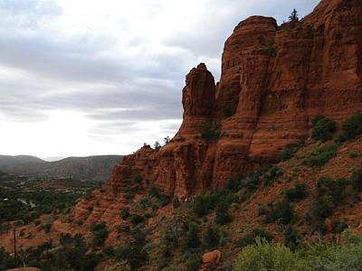 The Beautiful Hillside Of Sedona On A Cloudy Afternoon Poster