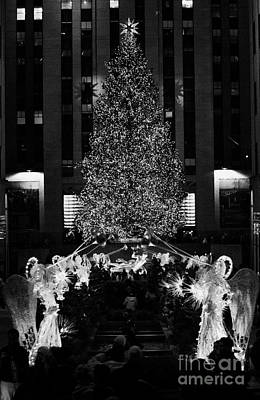 The Christmas Tree Lit Up At Night At The Rockefeller Centr New York City Poster
