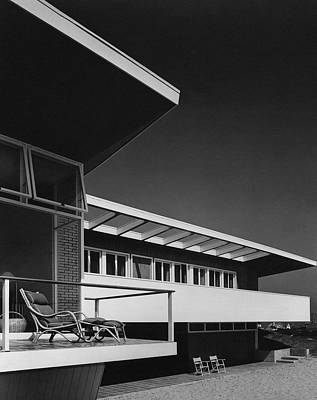 The Exterior Of A Beach House Poster by Robert M. Damora