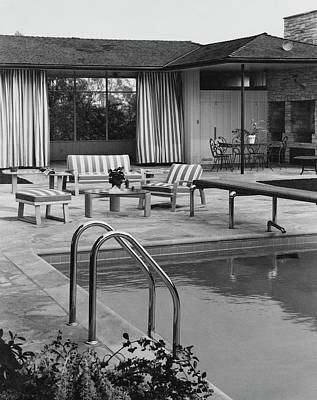 The Pool And Pavilion Of A House Poster