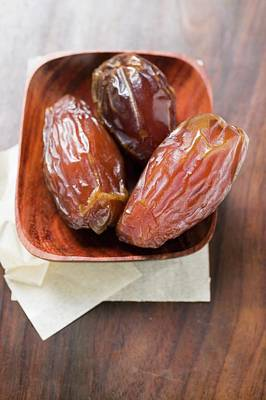 Three Dried Dates In Wooden Bowl Poster