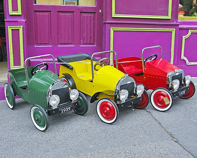 Three Pedal Cars Poster by David Thompson