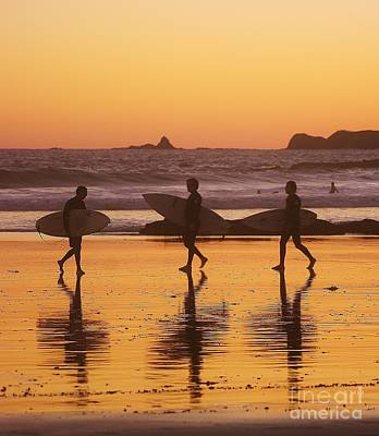 Three Surfers At Sunset Poster by Blair Stuart