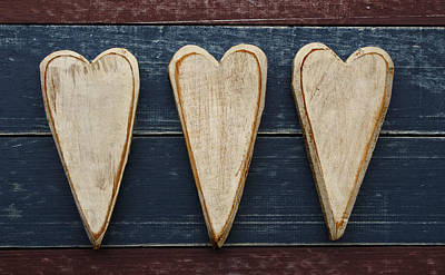 Three Wooden Hearts Poster by Carol Leigh